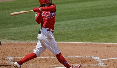 Philadelphia Phillies' Freddy Galvis hits a home run against the Tampa Bay Rays in the fourth inning of a spring training baseball game, Friday, March 31, 2017, in Clearwater, Fla. (AP Photo/John Raoux)