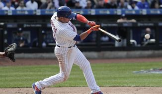 New York Mets' Asdrubal Cabrera connects for a base hit to center field to drive in Wilmer Flores during the seventh inning of a baseball game against the Atlanta Braves, Monday, April 3, 2017, in New York. (AP Photo/Julie Jacobson)