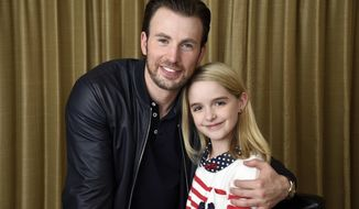 """In this March 23, 2017 photo, Chris Evans, left, and McKenna Grace, cast members in the film """"Gifted,"""" pose for a portrait at the Four Seasons Hotel in Los Angeles. Evans stars as a single guy raising his math-prodigy niece, played by Grace. (Photo by Chris Pizzello/Invision/AP)"""
