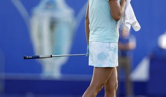 Lexi Thompson composes herself on 18th green during the final round of the LPGA Tour's ANA Inspiration golf tournament at Mission Hills Country Club in Rancho Mirage, Calif., Sunday, April 2, 2017. Earlier in the round, Thompson found out she had been assessed a four-stroke penalty for a rules violation Saturday. Thompson had a chance to win the tourney on 18, but left an eagle putt an inch short. So Yeon Ru won a playoff on the first hole. (AP Photo/Alex Gallardo)
