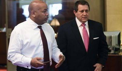 Assembly Speaker Carl Heastie, D-Bronx, left, speaks with New York Assembly Majority Leader Joseph Morelle as legislative leaders work on the state budget at the state Capitol on Monday, April 3, 2017, in Albany, N.Y. (AP Photo/Hans Pennink)