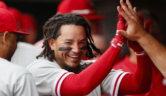 Philadelphia Phillies' Freddy Galvis celebrates his solo home run off Cincinnati Reds starting pitcher Scott Feldman in the second inning of a baseball game, Monday, April 3, 2017, in Cincinnati. (AP Photo/Gary Landers)