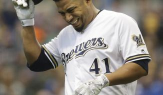 Milwaukee Brewers starting pitcher Junior Guerra grimaces after getting injured running to first base during the third inning of an opening day baseball game against the Colorado Rockies Monday, April 3, 2017, in Milwaukee. He did not return to pitch. (AP Photo/Jeffrey Phelps)