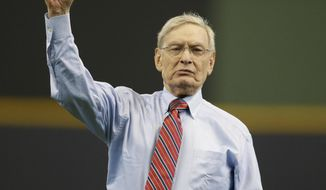 Former Baseball Commissioner Bud Selig throws out a ceremonial first pitch before an opening day baseball game between the Colorado Rockies and Milwaukee Brewers Monday, April 3, 2017, in Milwaukee. (AP Photo/Jeffrey Phelps)