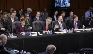 Democratic members of the Senate Judiciary Committee, from left, Sen. Amy Klobuchar, D-Minn., Sen. Al Franken, D-Minn., Sen. Chris Coons, D-Del., and Sen. Richard Blumenthal, D-Conn., question the Republican side as the panel meets to advance the nomination of President Donald Trump's Supreme Court nominee Neil Gorsuch, Monday, April 3, 2017, on Capitol Hill in Washington, Monday, April 3, 2017. (AP Photo/J. Scott Applewhite)