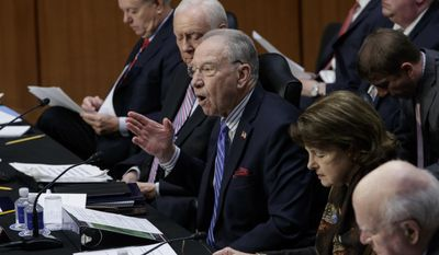 Senate Judiciary Committee Chairman Sen. Charles Grassley, R-Iowa, center, emphatically defends the nomination of President Donald Trump's Supreme Court nominee Neil Gorsuch to fill the vacancy left by the late Antonin Scalia, Monday, April 3, 2017, on Capitol Hill in Washington. From left are Sen. Lindsey Graham, R-S.C., Sen. Orrin Hatch, R-Utah, Grassley, ranking member Sen. Dianne Feinstein, D-Calif. and Sen. Patrick Leahy, D-Vt. (AP Photo/J. Scott Applewhite) ,
