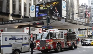 Police and fire vehicles respond to news of a train derailment at Penn Station, Monday, April 3, 2017, in New York. New Jersey Transit says one of its trains derailed while pulling into the station at a slow speed. There were no immediate reports of serious injuries, but New Jersey Transit and Amtrak had service delays. The derailment comes a week and a half after an Amtrak train partially derailed as it pulled out of Penn Station. (AP Photo/Mark Lennihan)