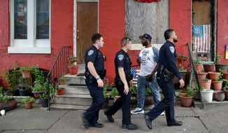 The Baltimore Police Department came under the review of federal authorities in the wake of unrest over the death of a young black man. Now, under a new administration, the Justice Department has requested a 90-day postponement of a hearing on a proposed consent agreement. (Associated Press/File)