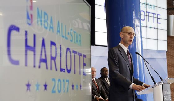 FILE - In this June 23, 2015, file photo, NBA Commissioner Adam Silver speaks during a news conference in Charlotte, N.C., where the league announced that the city would host the 2017 NBA All-Star basketball game.  A person with knowledge of the plans says the NBA will discuss whether to bring the 2019 All-Star Game to Charlotte at its Board of Governors meeting this week. The NBA pulled this year's event out of Charlotte and held it in New Orleans instead because of a North Carolina law that limits anti-discrimination protections for lesbian, gay and transgender people. The state recently passed a compromise law on the issue. (AP Photo/Chuck Burton, File)