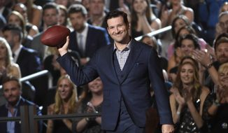 FILE - In this April 19, 2015, file photo, Tony Romo walks on stage at the 50th annual Academy of Country Music Awards at AT&T Stadium, in Arlington, Texas. A person with knowledge of the decision says Romo is retiring rather than trying to chase a Super Bowl with another team after losing his starting job with the Dallas Cowboys. The all-time passing leader for the storied franchise is headed to the broadcast booth after considering those offers. The person spoke to The Associated Press on condition of anonymity Tuesday, April 4, 2017, because Romo's decision hasn't been announced. (Photo by Chris Pizzello/Invision/AP, File)