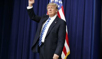 President Donald Trump pumps his fist during a town hall with business leaders in the South Court Auditorium on the White House complex in Washington, Tuesday, April 4, 2017. (AP Photo/Evan Vucci)