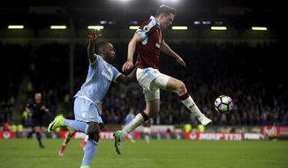 Burnley's Michael Keane, right, and Stoke City's Saido Berahino vie for the ball  during the English Premier League soccer match Burnley against Stoke City at Turf Moor, Burnley, England, Tuesday April 4, 2017. (Nick Potts/PA via AP)