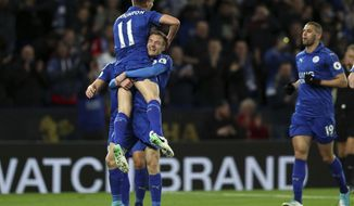 Leicester City's Jamie Vardy, centre rear, celebrates scoring his sides second goal with Marc Albrighton during the English Premier League match, Leicester against Sunderland at the King Power Stadium, Leicester, England, Tuesday April 4, 2017. (Mike Egerton/PA via AP)