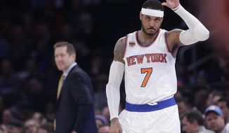 New York Knicks' Carmelo Anthony (7) checks in as Jeff Hornacek, left, watches during the first half of an NBA basketball game against the Chicago Bulls Tuesday, April 4, 2017, in New York. (AP Photo/Frank Franklin II)