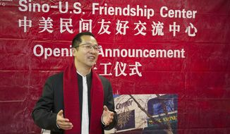In an April 2, 2017 photo, Glad Cheng, co-owner of China Windows Group, describes what the new Sino-U.S. Friendship Center will consist of during Monday's announcement of the opening of a Sini-U.S. Friendship Center in Muscatine, Iowa. Work to convert a former furniture store in downtown Muscatine into the center is expected to begin this month.  (Beth Van Zandt/Muscatine Journal via AP)