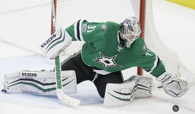 Dallas Stars goalie Antti Niemi (31) blocks an Arizona Coyotes shot during the third period of an NHL hockey game in Dallas, Tuesday, April 4, 2017. The Stars won 3-2 in overtime. (AP Photo/LM Otero)