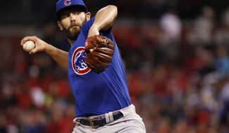 Chicago Cubs starting pitcher Jake Arrieta throws during the first inning of a baseball game against the St. Louis Cardinals Tuesday, April 4, 2017, in St. Louis. (AP Photo/Jeff Roberson)