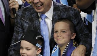 North Carolina head coach Roy Williams hugs his grandchildren as he celebrates after the finals of the Final Four NCAA college basketball tournament against Gonzaga, Monday, April 3, 2017, in Glendale, Ariz. North Carolina won 71-65. (AP Photo/David J. Phillip)