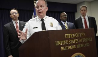 FILE - In this Wednesday, March 1, 2017, file photo, Baltimore Police Department Commissioner Kevin Davis speaks at a news conference in Baltimore to announce that seven Baltimore police officers who worked on a firearms crime task force are facing charges of stealing money, property and narcotics from people over two years. Baltimore Mayor Catherine Pugh and Davis worked closely with Justice Department investigators to scrutinize the city's police force and embraced a plan they crafted to overhaul the troubled department. (AP Photo/Patrick Semansky, File)