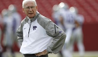 FILE - In this Oct. 29, 2016, file photo, Kansas State head coach Bill Snyder stands on the field before an NCAA college football game against Iowa State, in Ames, Iowa. Snyder has gone through spring practices dozens of times, including nearly 30 of them as head coach at Kansas State. What he's never done is try to juggle preparing a team expected to contend for a Big 12 title with treatments for throat cancer.  (AP Photo/Charlie Neibergall, File)