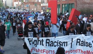 Supporters of the Black Lives Matter and Fight for $15 movements march down the streets of Memphis on the 49th anniversary of the assassination of civil rights leader Martin Luther King Jr. on Tuesday, April 4, 2017, in Memphis, Tenn. (AP Photo/Adrian Sainz)