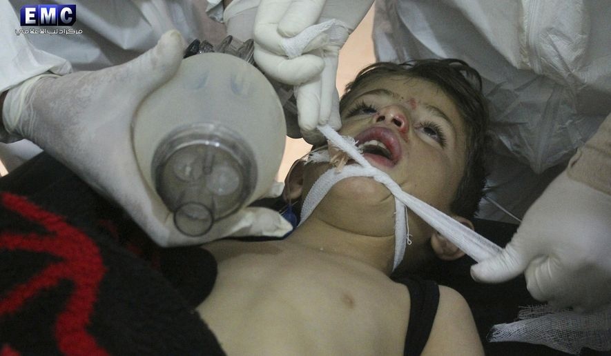 This photo provided Tuesday, April 4, 2017 by the Syrian anti-government activist group Edlib Media Center, which has been authenticated based on its contents and other AP reporting, shows  Syrian doctors treating a child following a suspected chemical attack, at a makeshift hospital, in the town of Khan Sheikhoun, northern Idlib province, Syria. The suspected chemical attack killed dozens of people on Tuesday, Syrian opposition activists said, describing the attack as among the worst in the country's six-year civil war. (Edlib Media Center, via AP)