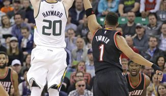 Utah Jazz forward Gordon Hayward (20) shoots as Portland Trail Blazers guard Evan Turner (1) defends during the first half in an NBA basketball game Tuesday, April 4, 2017, in Salt Lake City. (AP Photo/Rick Bowmer)