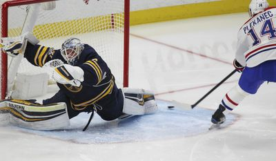 Montreal Canadiens forward Tomas Plekanec (14) puts the puck past Buffalo Sabres goalie Robin Lehner (40) during the third period of an NHL hockey game, Wednesday, April 5, 2017, in Buffalo, N.Y. (AP Photo/Jeffrey T. Barnes)