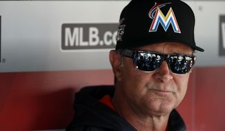 Miami Marlins manager Don Mattingly listens to a reporter's question during a media availability before an opening day baseball game against the Washington Nationals, at Nationals Park, Monday, April 3, 2017, in Washington. (AP Photo/Alex Brandon)