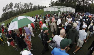 Fans leave Augusta National for a weather warning during a practice round for the Masters golf tournament Wednesday, April 5, 2017, in Augusta, Ga. (AP Photo/Chris Carlson)