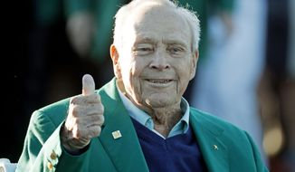 FILE - In this April 7, 2016, file photo, Arnold Palmer gives a thumbs up before the ceremonial first tee before the first round of the Masters golf tournament, in Augusta, Ga. The King turned up one last time at the Masters, in ill health but still flashing that familiar thumbs-up sign. Now, it's time to carry on without Arnold Palmer, whose death left a giant void at Augusta National and golf's first major championship. (AP Photo/Charlie Riedel, File)