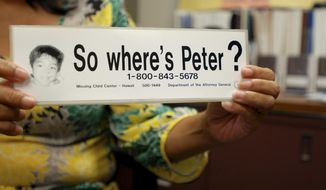 "This June 6, 2016 photo taken in Honolulu shows a bumper sticker Hawaii officials distributed in a campaign for a Hawaii boy who disappeared 20 years ago. The child, known as ""Peter Boy,"" became the face of missing and abused children in the late 1990s and early 2000s. The father of the boy is expected to appear in court for a hearing Wednesday, April 5, 2017, where it's possible he'll accept a plea deal in the murder case against him. (AP Photo/Jennifer Sinco Kelleher)"