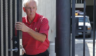 """FILE - In this May 19, 2017, file photo, William """"Billy"""" Walters walks out of the federal court house in Las Vegas. Prosecutors, in closing arguments Wednesday, April 5, 2017, urged a New York jury to find Walters, a professional Las Vegas gambler linked to golfer Phil Mickelson, guilty of earning tens of millions of dollars illegally in the stock market. Prosecutors say trading and phone records back up the testimony of a former Dean Foods Co. board member who said he gave secrets to Walters.  (AP Photo/John Locher, File)"""