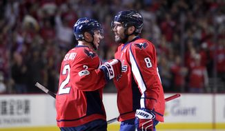Washington Capitals left wing Alex Ovechkin (8), of Russia, celebrates his goal with defenseman Matt Niskanen (2) during the second period of an NHL hockey game against the New York Rangers, Wednesday, April 5, 2017, in Washington. (AP Photo/Nick Wass)