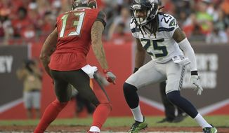 FILE - In this Nov. 27, 2016, file photo, Seattle Seahawks cornerback Richard Sherman (25) covers Tampa Bay Buccaneers wide receiver Mike Evans (13) during the second quarter of an NFL football game, in Tampa, Fla. Seahawks general manager John Schneider acknowledged the team has listened to trade offers regarding cornerback Richard Sherman, but downplayed that a deal may actually happen. Schneider made his comments in an interview with KIRO-AM on Wednesday, April 5, 2017. (AP Photo/Phelan Ebenhack, File)