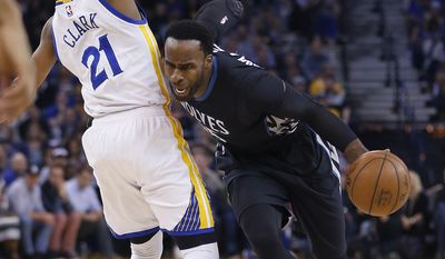 Minnesota Timberwolves forward Shabazz Muhammad (15) drives around Golden State Warriors guard Ian Clark (21) during the first half of an NBA basketball game Tuesday, April 4, 2017, in Oakland, Calif. (AP Photo/Tony Avelar)