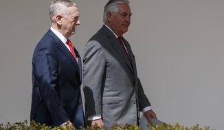 Defense Secretary Jim Mattis, left, walks with Secretary of State Rex Tillerson to a lunch with President Donald Trump and Egyptian President Abdel Fattah al-Sisi at the White House in Washington, Monday, April 3, 2017. (AP Photo/Evan Vucci)