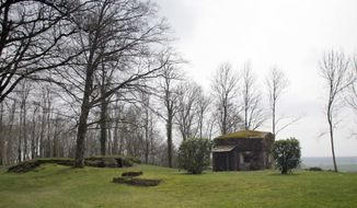 In this photo taken on Friday, March 24, 2017, a German World War I bunker, currently being used as a shed, sits atop the ridge in Montfaucon, France. An American monument on the hill commemorates the American victory during the Meuse-Argonne Offensive during the period September 26, 1918 to November 11, 1918. (AP Photo/Virginia Mayo)