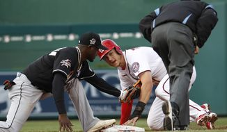 Washington Nationals' Trea Turner (7) looks for the call after stealing second against Miami Marlins second baseman Dee Gordon (9) during the third inning of a baseball game in Washington, Thursday, April 6, 2017. (AP Photo/Manuel Balce Ceneta)