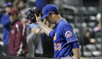 New York Mets starting pitcher Matt Harvey (33) leaves gestures to fans as he leaves the game during the seventh inning of a baseball game against the Atlanta Braves Thursday, April 6, 2017, in New York. (AP Photo/Frank Franklin II)