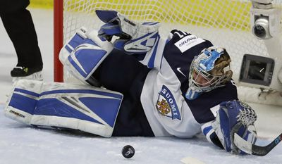 Finland goalie Noora Raty deflects a shot during the first period of an IIHF women's world hockey championship semifinal game against Canada on Thursday, April 6, 2017, in Plymouth, Mich. (AP Photo/Carlos Osorio)