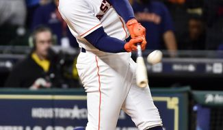 Houston Astros' George Springer hits a walk-off three-run home run in the 13th inning of a baseball game against the Seattle Mariners, Wednesday, April 5, 2017, in Houston. (AP Photo/Eric Christian Smith)