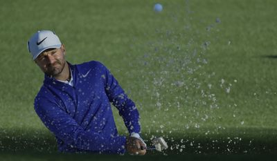 Trevor Immelman of South Africa, hits from a bunker on the second hole during the first round for the Masters golf tournament Thursday, April 6, 2017, in Augusta, Ga. (AP Photo/Chris Carlson)