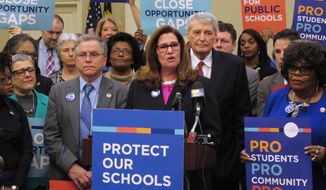 Betty Weller, president of the Maryland State Education Association, stands with Maryland Democrats on Thursday, April 6, 2017, in Annapolis, Md., while urging lawmakers to override Republican Gov. Larry Hogan's veto of a Maryland plan for identifying and assisting struggling schools. The Maryland General Assembly overrode the veto later in the day. (AP Photo/Brian Witte)
