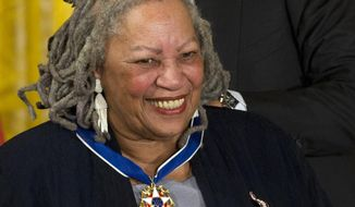 FILE - In this May 29, 2012 file photo, author Toni Morrison receives her Medal of Freedom award during a ceremony in the East Room of the White House in Washington. The Pulitzer Prize-winning novelist is scheduled to be presented with the American Academy of Arts and Sciences' Emerson-Thoreau Medal on Thursday evening, April 6, 2017, at the Academy's headquarters in Cambridge, Mass. (AP Photo/Carolyn Kaster, File)