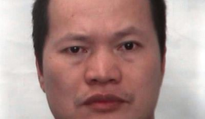 This undated booking photo provided by the Hawaii Department of Public Safety shows Wei Li who was convicted after pleading no-contest to racketeering-related charges. Li is facing deportation to China after being convicted of trafficking Chinese women to work as prostitutes in Hawaii massage parlors. (Hawaii Department of Public Safety via AP)