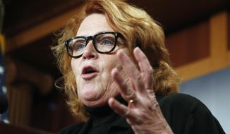 FILE - In this March 14, 2017, file photo, Sen. Heidi Heitkamp, D-N.D., speaks during a news conference on Capitol Hill in Washington. Left-leaning voters in North Dakota are grappling with Heitkamp's support of President Donald Trump's Supreme Court nominee, with some of them tempering disappointment with an acknowledgement of her looming re-election fight in a conservative state. (AP Photo/Manuel Balce Ceneta, File)