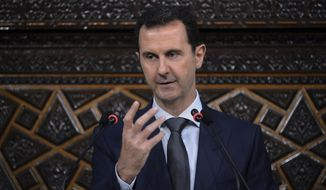 FILE - In this June 7, 2016 file photo released by the Syrian official news agency SANA, Syrian President Bashar Assad, addresses a speech to the newly-elected parliament at the parliament building, in Damascus, Syria.  Assad's government came under mounting international pressure Thursday, April 6, 2017 after a chemical attack in northern Syria, with even key ally Russia saying its support is not unconditional. (SANA via AP)