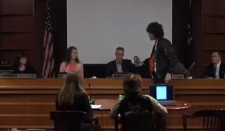 Portland Mayor Ted Wheeler scolded a protester who rapidly approached him with a can of Pepsi during a city council meeting Wednesday. (The Oregonian)