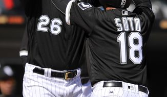 Chicago White Sox's Geovany Soto (18) celebrates with teammate Avisail Garcia (26) at home plate after hitting a three-run home run during the third inning of a baseball game against the Detroit Tigers Thursday, April 6, 2017, in Chicago. (AP Photo/Paul Beaty)